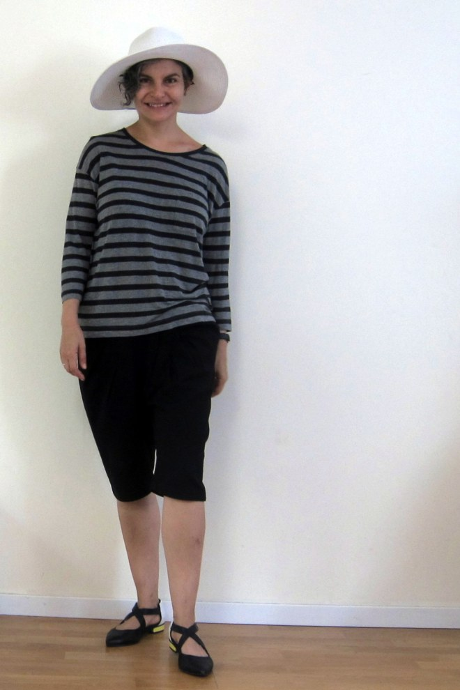 Vince top: second hand, Cassidi shorts: thrifted, Daniella Lehavi shoes, Columbia Sportswear hat